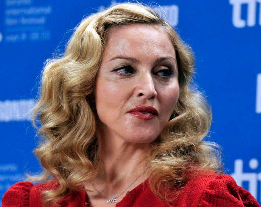 "Director Madonna poses before the news conference for the film ""W.E."" at the 36th Toronto International Film Festival"