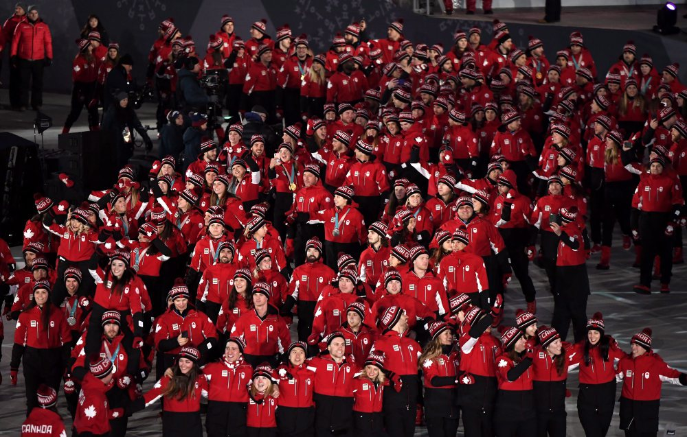 Canadian athletes enter the stadium during the closing ceremonies at the 2018 Pyeongchang Olympic Winter Games in Pyeongchang, South Korea, on Sunday, February 25, 2018. THE CANADIAN PRESS/Paul Chiasson